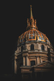 Low-angle view of Les Invalides dome at night