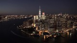 New York City aerial view of Lower Manhattan's Financial District at night the Battery Maritime Building and the East River, with Midtown Manhattan in the background - 198150746
