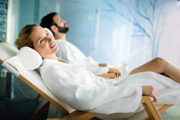 Handsome man and beautiful woman relaxing in spa