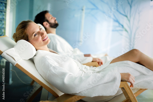 Leinwanddruck Bild Handsome man and beautiful woman relaxing in spa