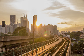 Sun rise brings a new day to the rapidly growing high tech city of Kuala Lumpur in Asia and is a good example of the regions booming economies and infrastructure