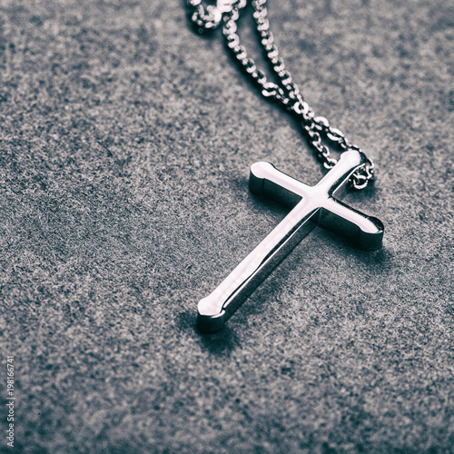 Silver cross on a gray background - 198166741