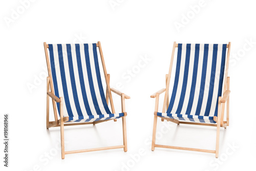 two striped beach chairs, isolated on white