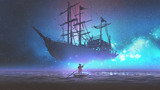 little boy rowing a boat in the sea and looking at the sailing ship floating in starry sky, digitl art style, illustration painting - 198169719