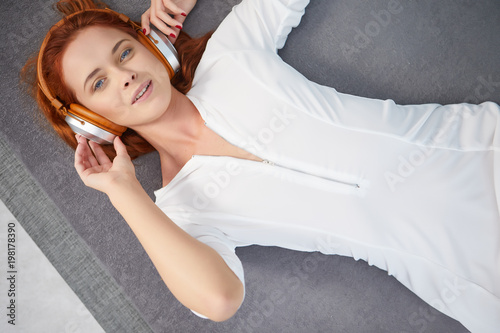 the image of resting sexy woman listening to vinyl - 198178390