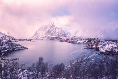 Foto op Plexiglas Lichtroze Dramatic Norwegian winter landscape during storm at sunset, Reine - favorite tourist destination in the Lofoten Islands, Northern Norway