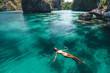 Woman swimming in clear sea water in Asia