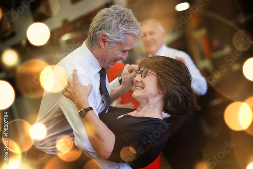 Romantic senior couple dancing together at dance hall - 198207784