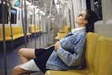 Sexy model is posing in carriage of metro train - 198213533
