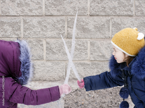 Epic battle of children with huge icicles