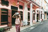 Boho girl walking on the city street