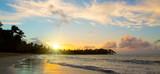 Caribbean sunset on tropical beach.
