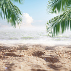 Hello summer , Tropical Sand beach with sea and coconut palm leaves in relaxation time. Happiness and relax on the beach during summer concept.