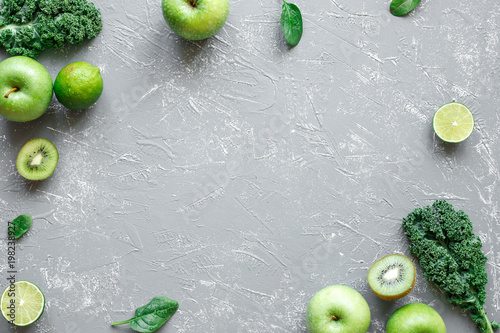 Fresh green fruits, kale and spinach on gray background with copy space, top view - 198238927