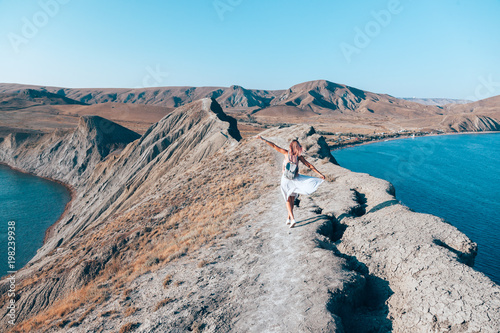 Girl walking on the mountain top