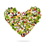 Heart shape made of various kind of vegetable on white