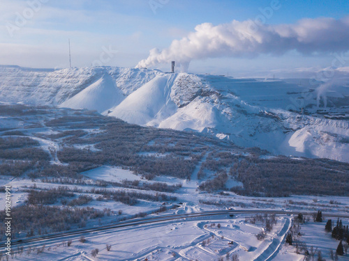 Aerial winter view of Kiruna, the northernmost town in Sweden, province of Lapland, winter sunny picture shot from drone © tsuguliev