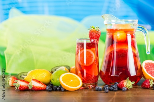 Foto Murales Refreshing fruits juice with Fruits