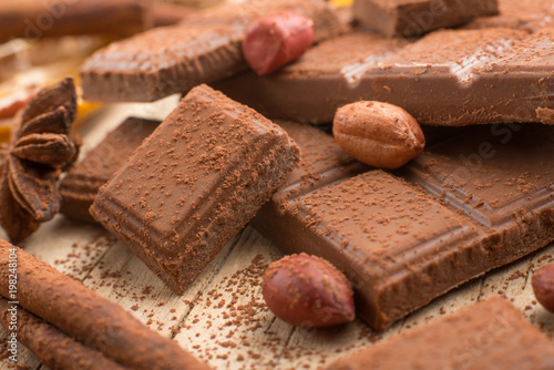 Milk chocolate with nuts, and spices. Macro - 198248104