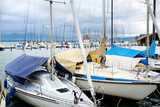 Beautiful yachts in a harbor of Lindau, a town on the coast of Bodensee lake, in Germany, on cloudy autumn day
