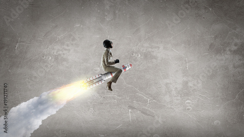 Woman on space rocket . Mixed media