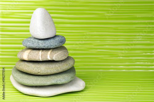 Foto op Canvas Zen Multicolored zen stones on a wavy surface