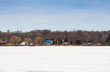 Cottages and homes on a frozen lake