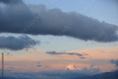 In de dag Ochtendgloren clouds over high altitude mountains during sunrise