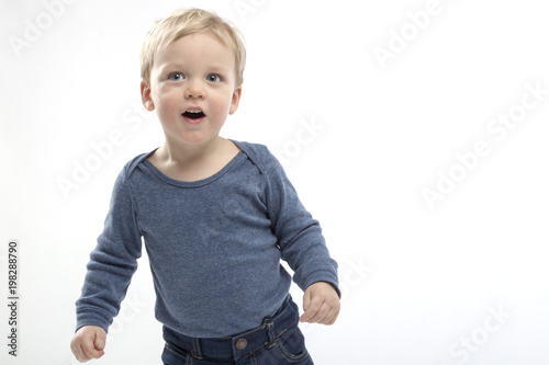 excited open mouthed two years toddler on the white background. copy space