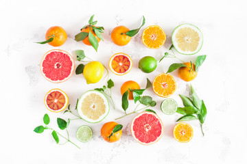 Fruit background. Colorful fresh fruits on white table. Orange, tangerine, lime, lemon, grapefruit. Flat lay, top view