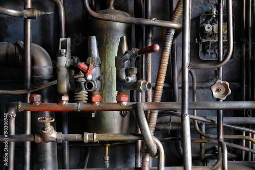 Fotobehang Oude verlaten gebouwen Dark industrial interior with metal rusty old pipes