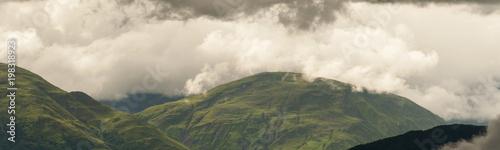 Fotobehang Khaki bad weather over the green hills of the Cerros de Pereyra