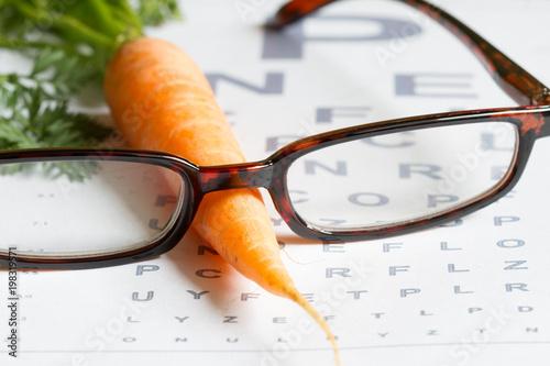 Carrot vitamin A and eye test chart healt medical concept