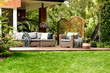 Veranda surrounded by green grass