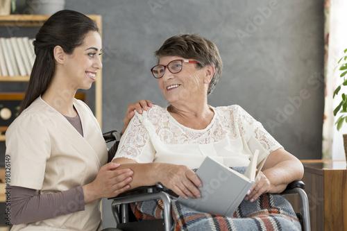 Foto Murales Woman in wheelchair with nurse