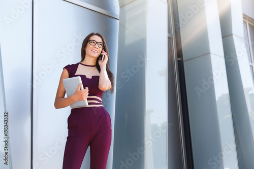 Businesswoman talking on smartphone outdoors