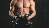 Muscular Bodybuilder Guy Doing Exercises With Dumbbells Over Black Background - 198386339