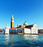 Venice. View from the water at the Cathedral of San Giorgio Maggiore in the sunset