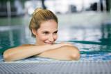 Portrait of beautiful woman relaxing in swimming pool - 198438383