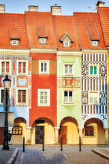 Merchant houses in the Poznan Old Market Square at sunrise, Poland.