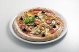 Pizza mozzarella tomato salami and grilled vegetables