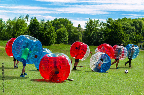 Plexiglas Voetbal Children playing in Bubble Football