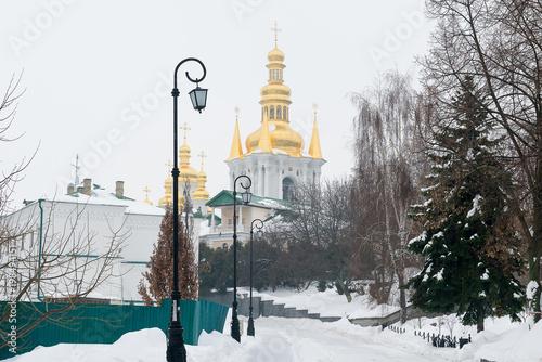 Foto op Plexiglas Kiev Kiev, Ukraine. Pechersk Lavra Monastery. A snow-covered avenue leading to distant caves.