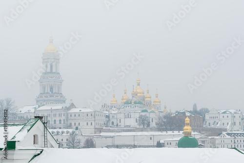 Foto op Plexiglas Kiev Kiev, Ukraine. A snowy foggy morning in the Kiev-Pechersk Lavra.