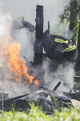 Photo of a fire in an old wooden house - 198513748