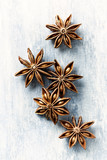 Star anise, spice fruits and seeds on wooden background. Food background. Top view.  - 198546765