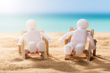 Two Human Figures Relaxing On Deck Chairs