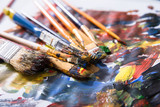 Close-up Of Various Messy Paintbrushes - 198550710