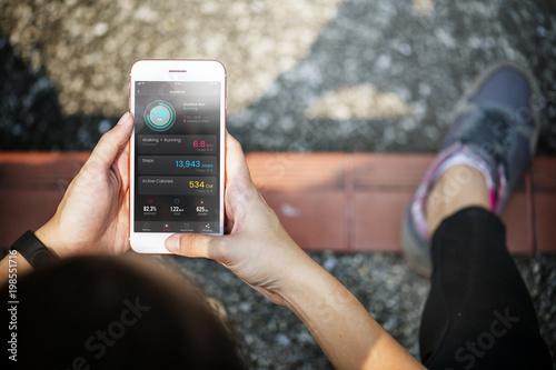 Fotobehang Hoogte schaal Active woman using a digital device
