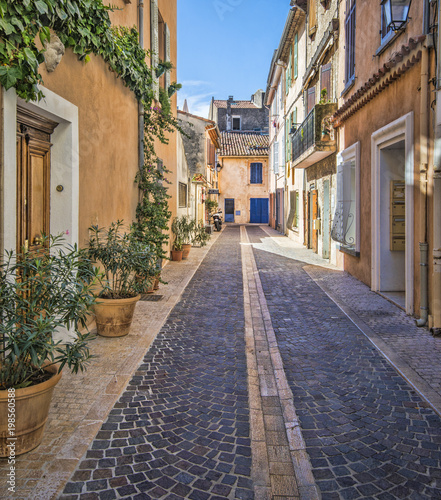 Fotobehang Smalle straatjes Charming, stone street of colorful, old homes in Southern France